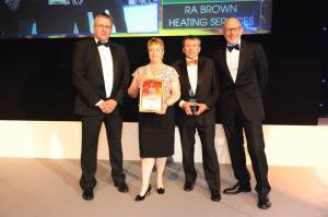 Louise & Richard receiving heat pump award