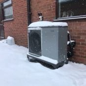 NIBE air source heat pump in the snow